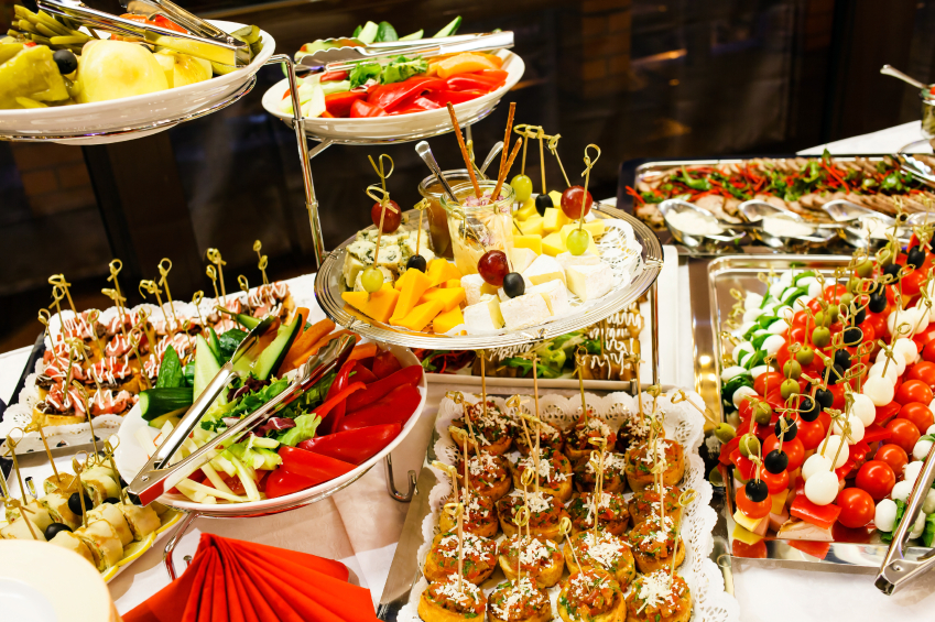 A buffet table loaded with food