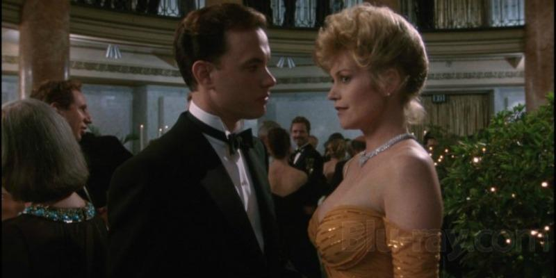 Tom Cruise talks to Melanie Griffith as they are dressed up for a party in The Bonfire of the Vanities.