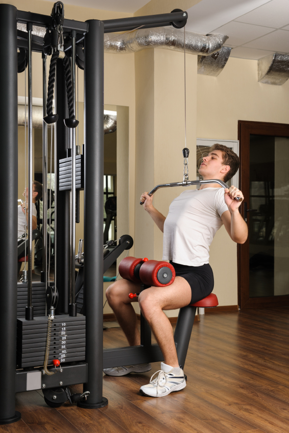 young man doing lats pull-down workout