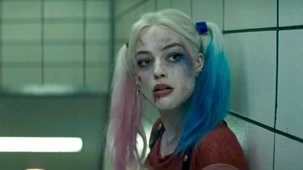 Margot Robbie as Harley Quinn against a white tile wall in Suicide Squad