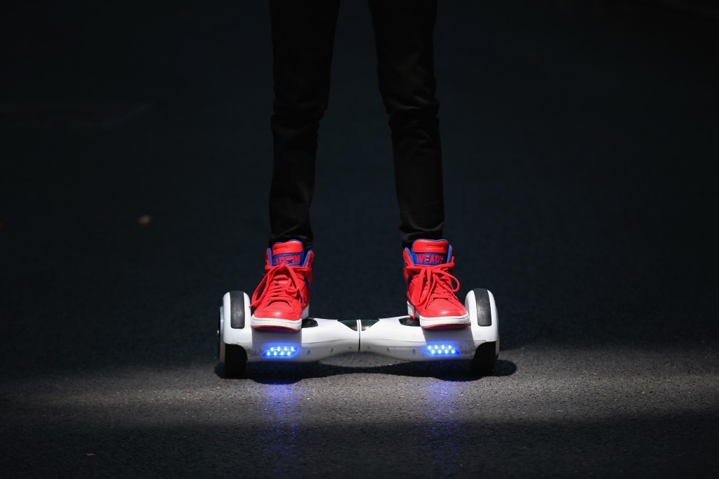 A youth poses as he rides a hoverboard, which are also known as self-balancing scooters and balance boards, on October 13, 2015 in Knutsford, England. The British Crown Prosecution Service have declared that the devices are illegal as they are are too unsafe to ride on the road, and too dangerous to ride on the pavement. (Photo by Christopher Furlong/Getty Images)