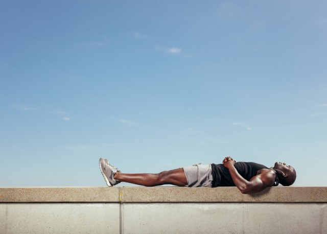 Man lying down after workout to think