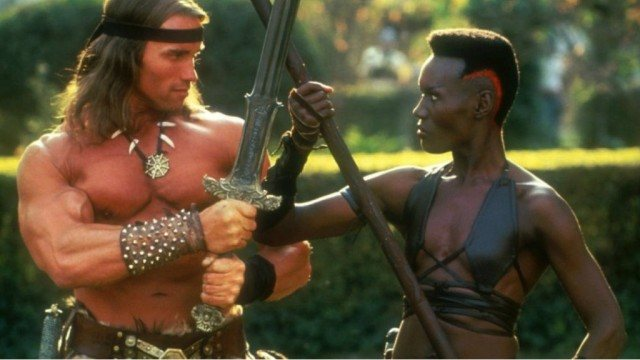 Arnold Schwarzenegger and Grace Jones in a stare down