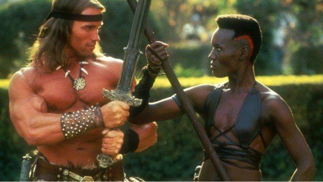Arnold Schwarzenegger and Grace Jones in a stare down