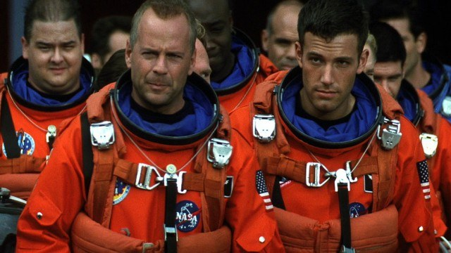 Bruce Willis and Ben Affleck wear orange space suits in 'Armageddon'