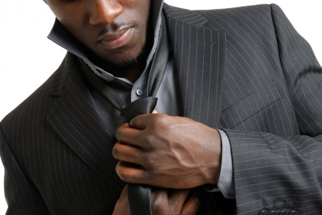 Man knotting his tie