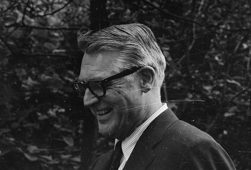 Actor Cary Grant is wearing glasses in a black and white photo.