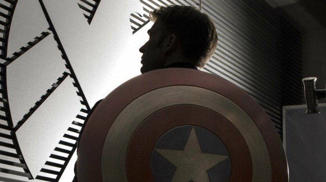 Captain America, silhouetted, wearing his trademark shield on his back