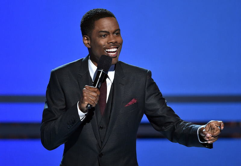 Chris Rock is talking on stage.