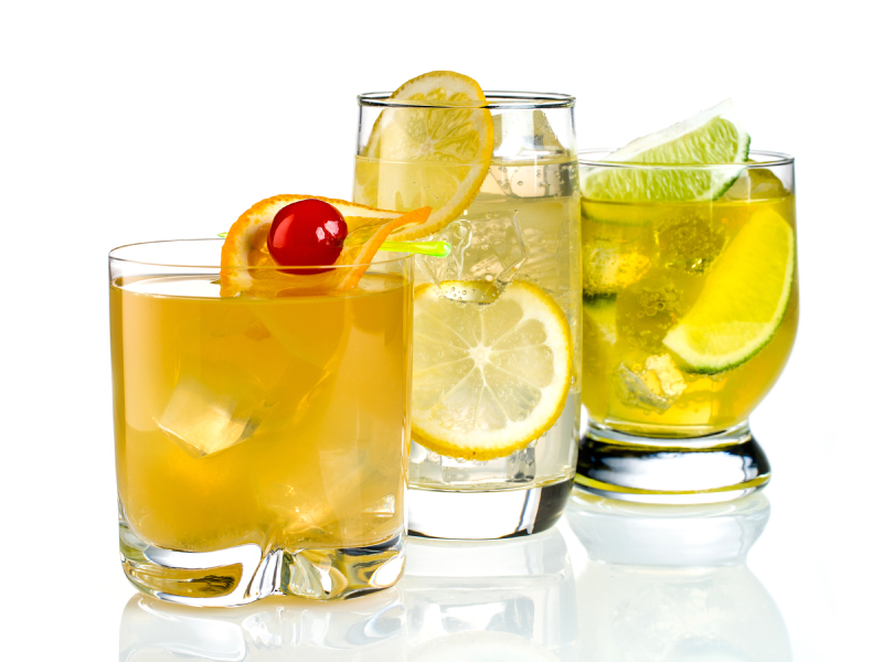 trio of cocktails with citrus fruits on a white background
