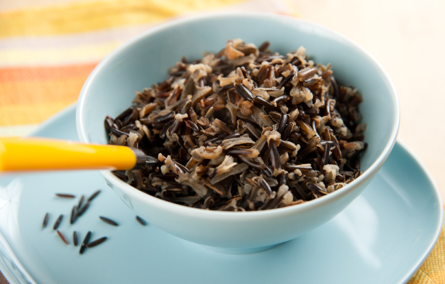 bowl of cooked wild rice with a spoon