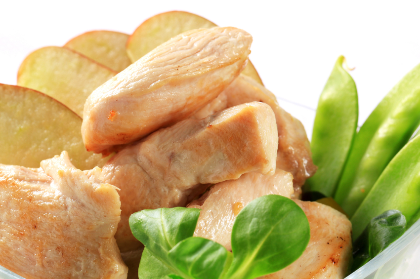 close-up of chicken breast with apples and pea pods