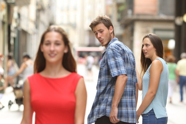 man looking at another woman