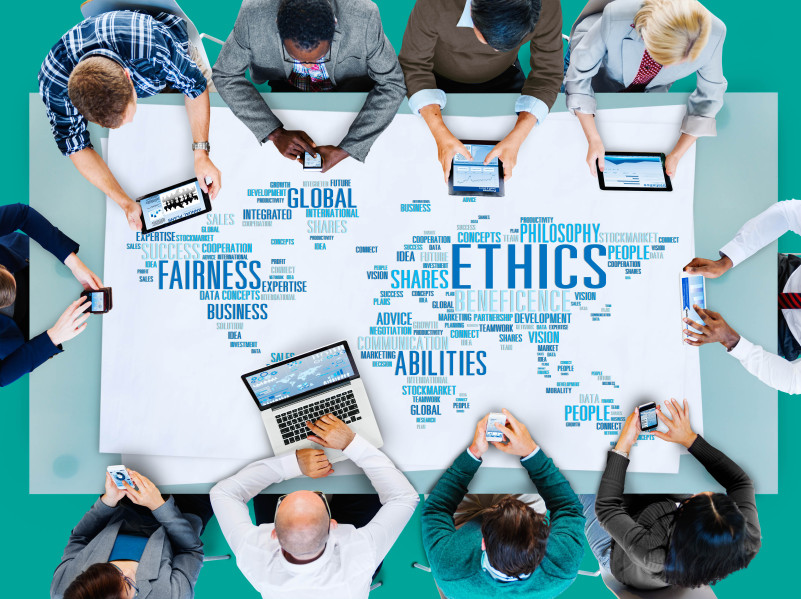 workers around word cloud about ethics