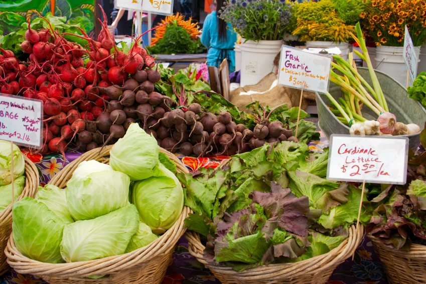 Baskets of fresh lettuce, beets, and cabbage