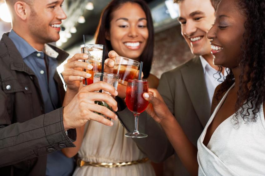 friends toasting at a bar