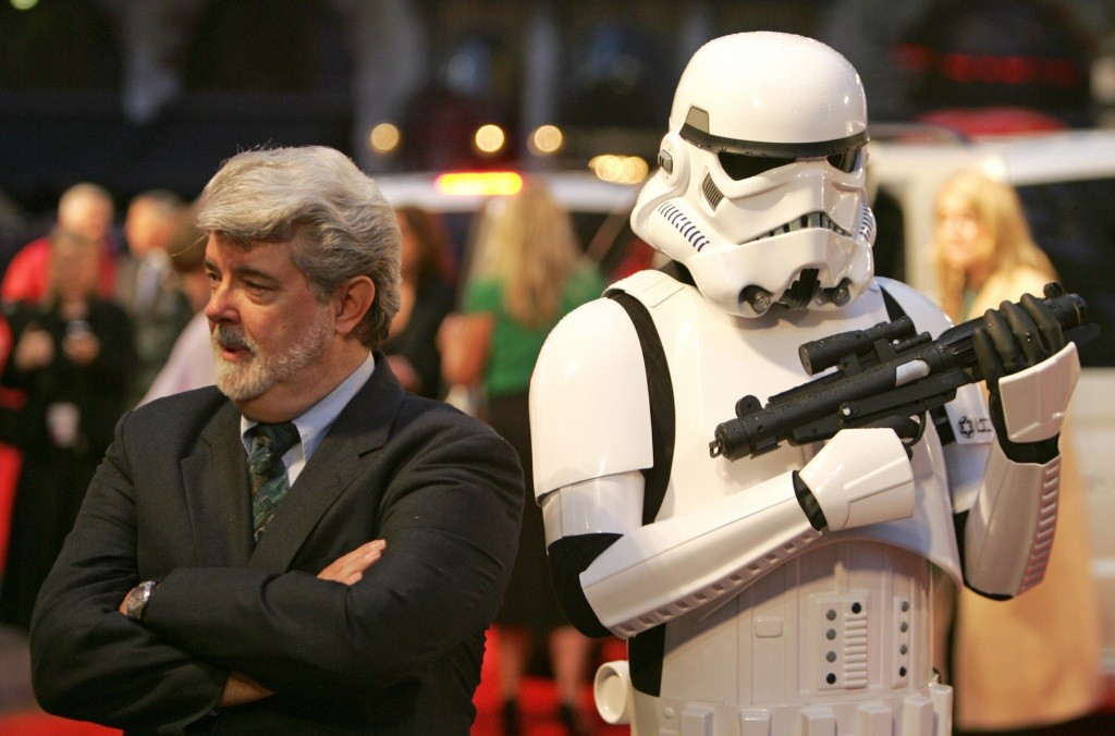 George Lucas and a Stormtrooper stand back to back
