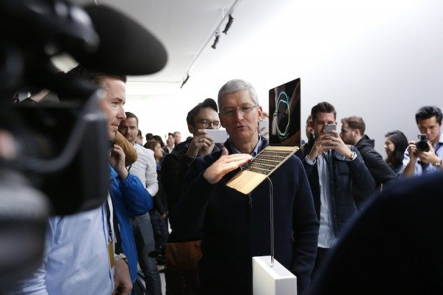 Apple CEO Tim Cook with a Mac computer