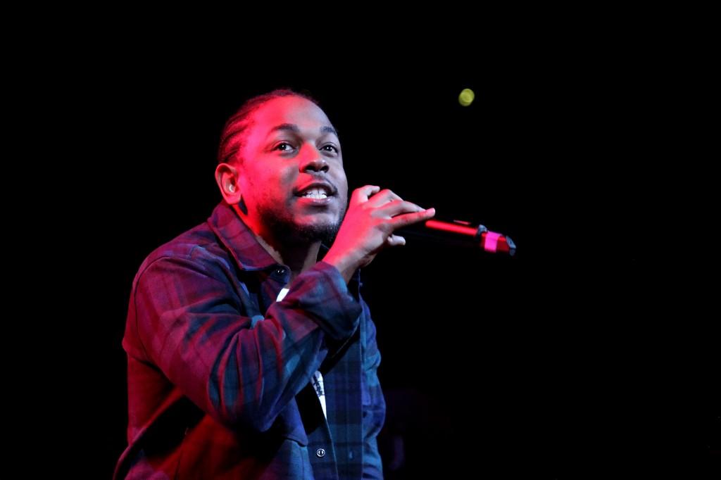 Kendrick Lamar performing on stage.