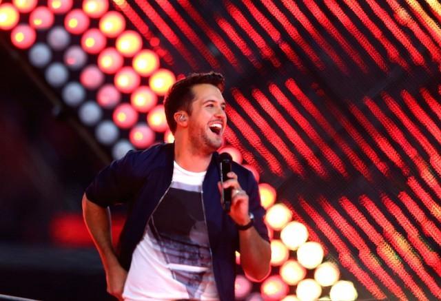 Luke Bryan is performing on stage.