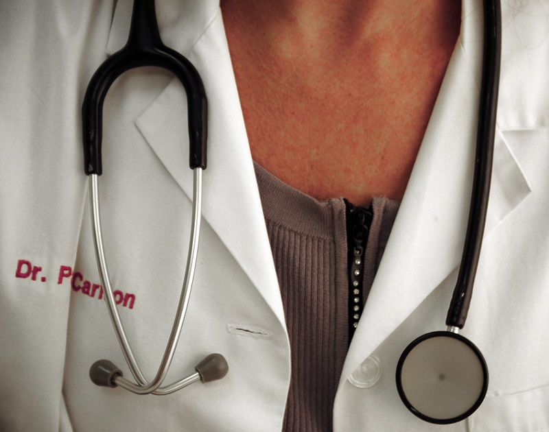 A doctor wearing a medical instrument