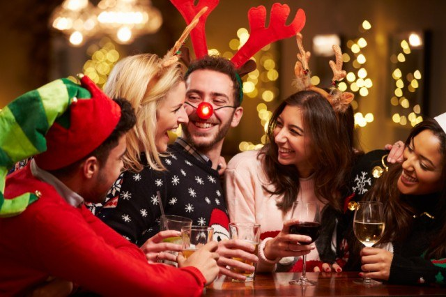 group of people drinking during the holidays