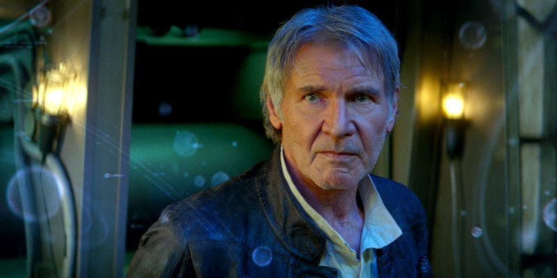 An older Han Solo looks concerned, glancing to the left of the frame