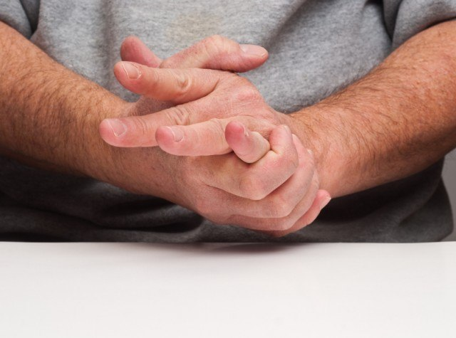 Man holding his hand in pain