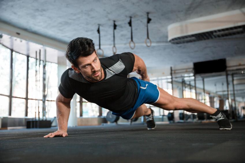 A man glares while doing pushup