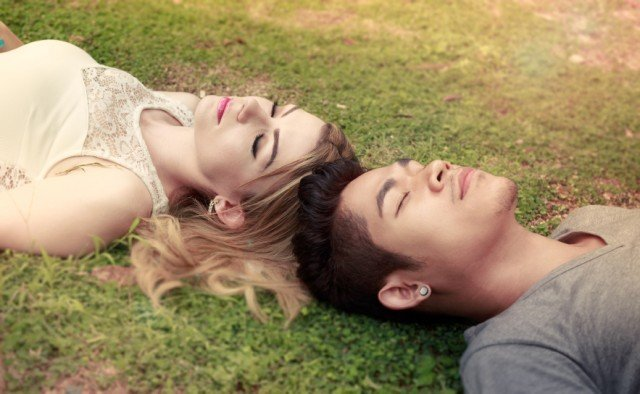 couple outside in the grass