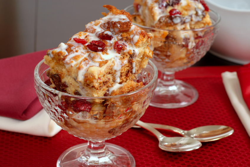 pannettone bread pudding with cranberries and glze in glass goblets