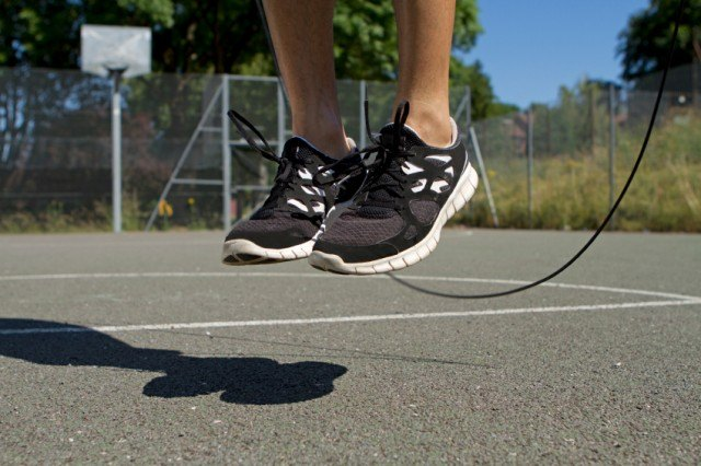 feet jumping rope on basketball court
