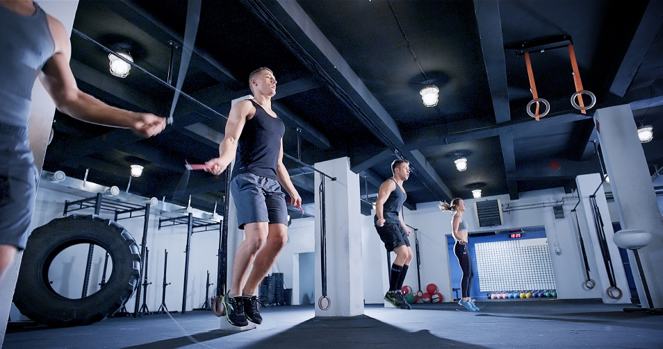 CrossFit members warm up by jumping rope