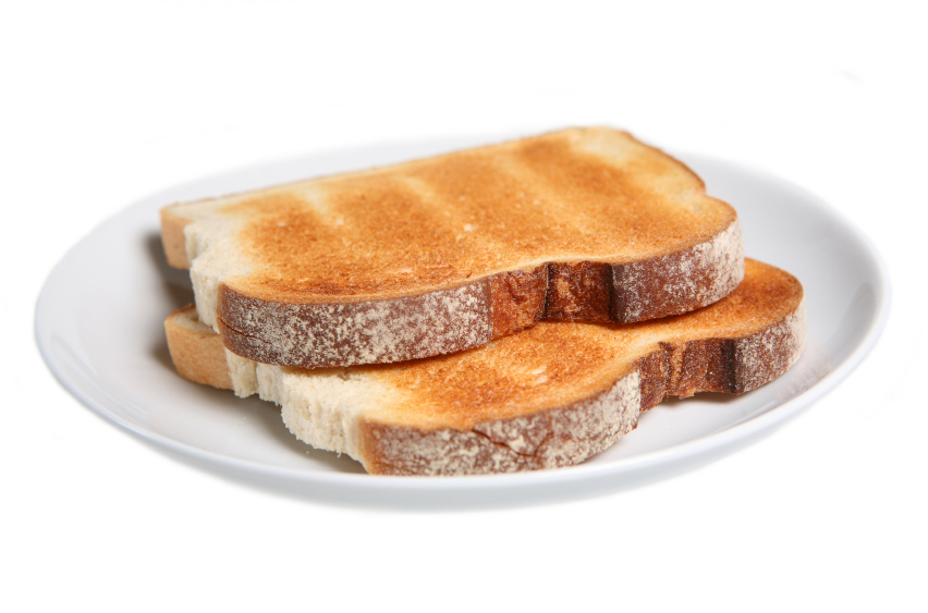 two slices of plain toast on a white plate