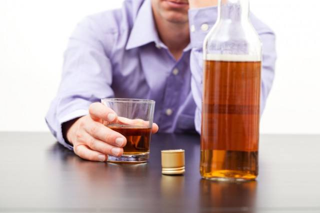 Man drinking scotch