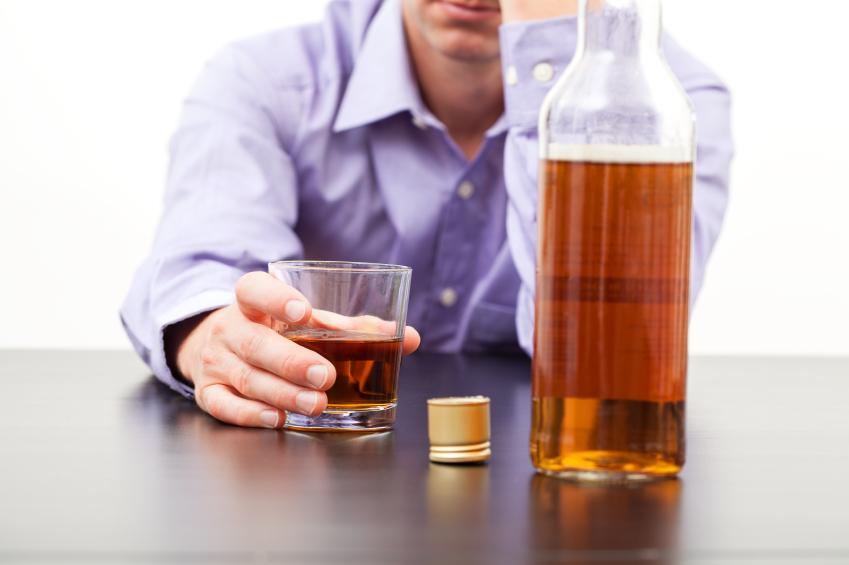man drinking liquor