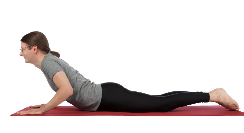 man in cobra pose, yoga