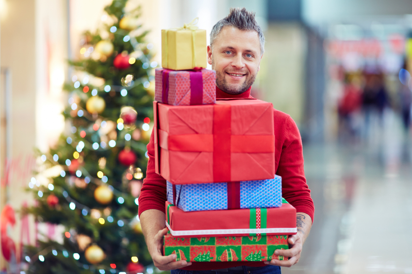 man holding stack of presents