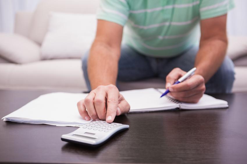 man with calculator
