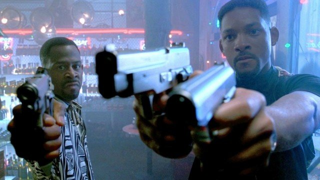 Martin Lawrence and Will Smith hold up guns in Bad Boys