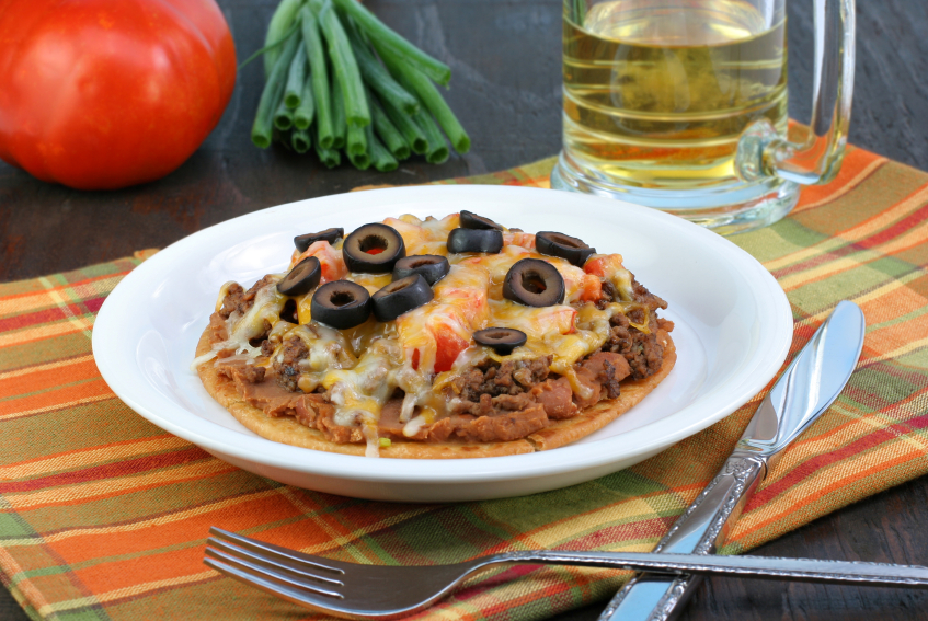 Mexican pizza with black olives, beef, and beans