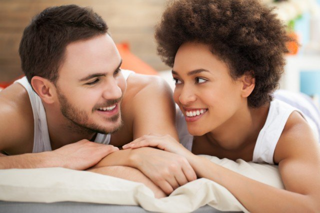 Man and woman smiling at each other