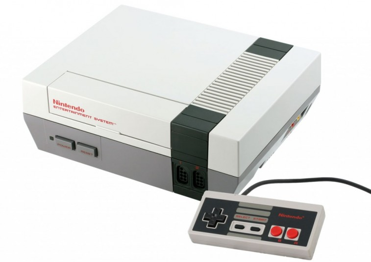 A Nintendo Entertainment System and controller on a white background.