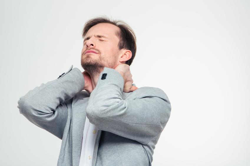 Portrait of a young businessman having neck pain