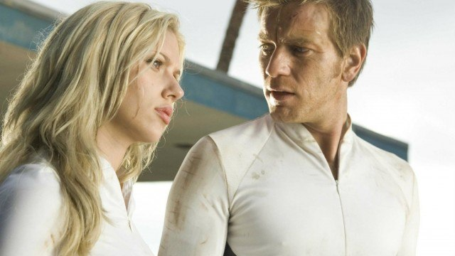 Scarlett Johansson and Ewan McGregor stand next to each other in 'The Island'