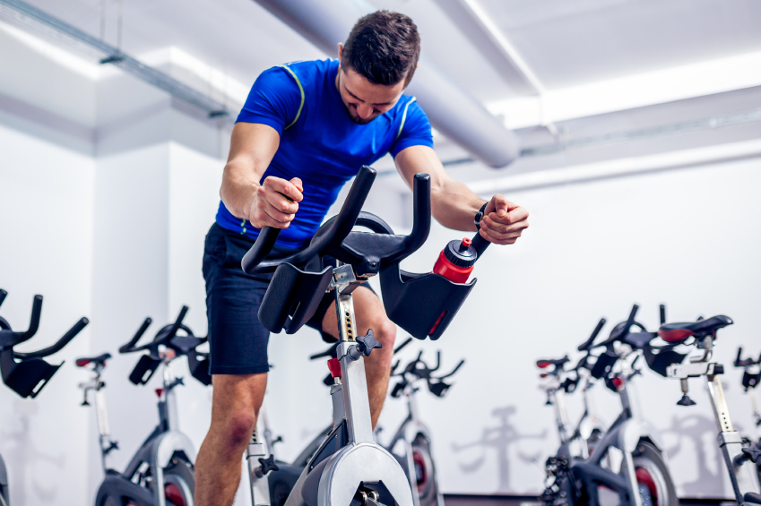 Man in blue shirt on an exercise bike