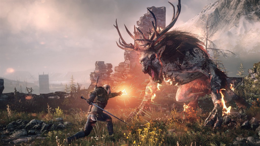 Geralt the witcher uses a fire spell on a giant fantasy beast.