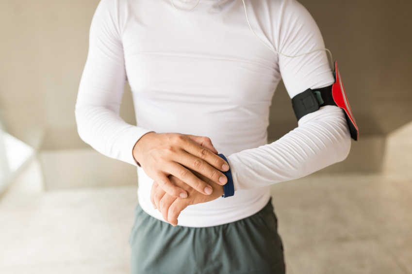 A man uses a fitness tracker