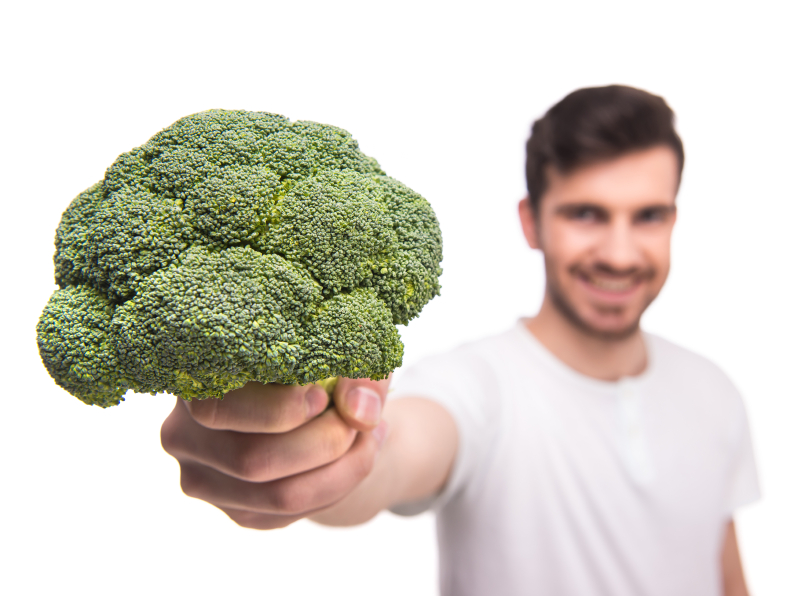 Man offerring broccoli a healthy foods