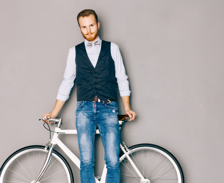 well-groomed man by his bike